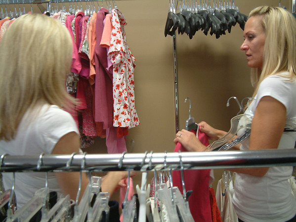 """Record-Eagle/Marta Hepler Drahos<br /> Lisa Schmidt, right, chats with Erica Mohr as they volunteer with """"Chicks for Charity"""" at The Father Fred Foundation."""