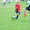 Record-Eagle/James Cook<br /> Traverse City North Storm's Keegan Sutherland (10) boots the ball during a game against Kalamazoo in the U-10 Boys Select tournament. The North Storm won the game 9-4.