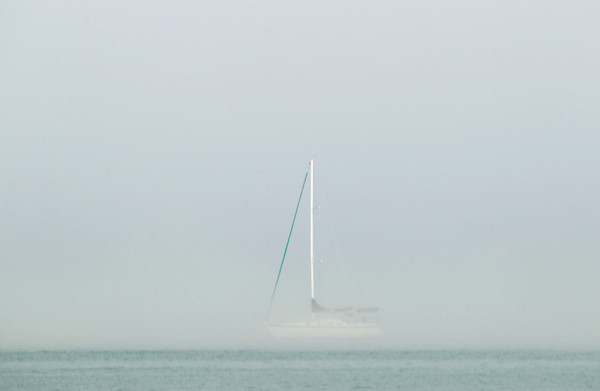 Record-Eagle/Keith King<br /> The mast of a sailboat is visible through heavy fog Monday, May 20, 2013 on West Grand Traverse Bay.