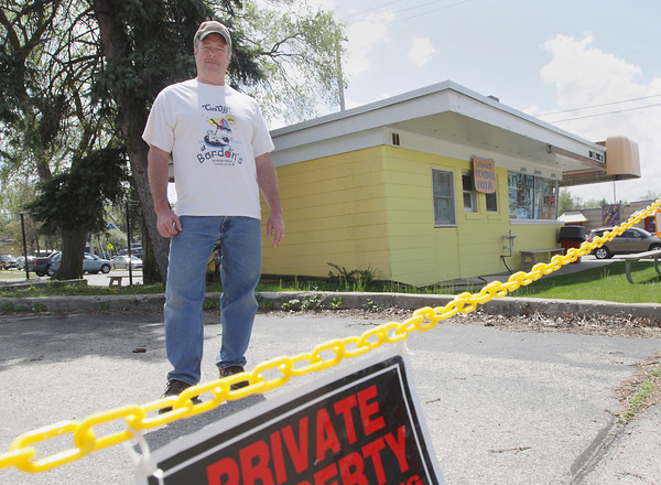 Record-Eagle/Keith King<br /> Jim Kratky with Bardon's Wonder Freeze stands near a blocked off entrance Tuesday, May 21, 2013 at the former Arby's near the intersection of Garfield Avenue and Front Street in Traverse City.