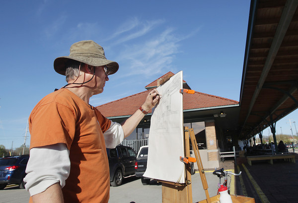 Record-Eagle/Keith King<br /> Claud Mills, of Traverse City, creates a pencil drawing Wednesday, May 15, 2013 at the old railroad depot near Woodmere Avenue and Eighth Street in Traverse City.