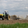 Record-Eagle/Keith King<br /> Richard Dennett drives a tractor as he plants corn in his field in Buckley.