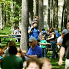 Record-Eagle/Keith King<br /> Jeff Godin, of Traverse City, carries his son Mason, 3, and guides his son, Aaron, 5, toward the beverage tent while Jeff's wife, Rose Godin, to right of Aaron, secures a table Sunday during the 56th annual Northwestern Michigan College Barbecue.