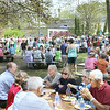 Record-Eagle/Keith King<br /> Barbecue attendees eat and enjoy the sunshine.