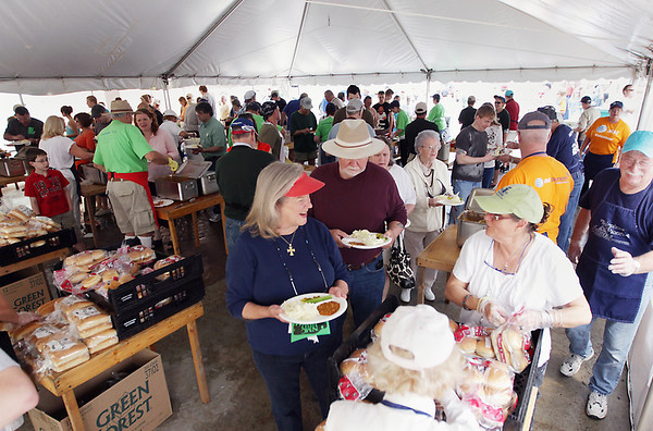 Record-Eagle/Keith King<br /> Martha Ealy, of Manton, and her husband Ray, are served food Sunday during the 56th annual Northwestern Michigan College Barbecue.