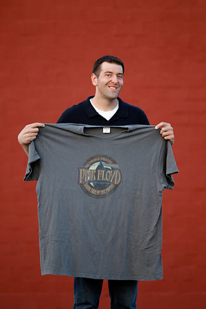 Record-Eagle/Jan-Michael Stump<br /> Since losing 200 pounds, Record-Eagle sports writer Mike Eckert -- shown holding a 5XL shirt he used to wear five years ago -- will run in his sixth marathon in Saturday's Bayshore Marathon.