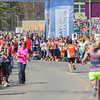 Record-Eagle/Keith King<br /> Spectators cheer for runners as they near the finish line during the 32nd annual Bayshore running races.
