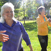 Record-Eagle/Allison Batdorff<br /> Joan D'Argo, left, and Nance Belton, right, demonstrate qigong moves in Traverse City's Lay Park. The pair are offering a free lunch break class from noon-12:30 p.m. on Tuesdays and Thursdays starting this week.