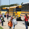 Record-Eagle/Keith King<br /> Students walk as buses are parked to pick them up at the end of the school day at Courtade Elementary School.