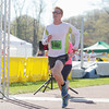 Record-Eagle/Keith King<br /> David Mart crosses the finish line to finish first in the 32nd annual Bayshore marathon.