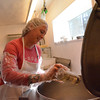 Record-Eagle/Allison Batdorff<br /> Sue Kurta adds rosemary to the Montasio cheese at Boss Mouse Cheese in Kingsley.
