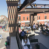 Record-Eagle/Keith King<br /> People sit on the outdoor patio at The Franklin on the corner of Front Street and Cass Street in downtown Traverse City.