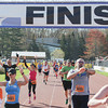 Record-Eagle/Keith King<br /> Runners finish the 32nd annual Bayshore running races in Traverse City.