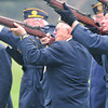 Record-Eagle/Nathan Payne<br /> Four riflemen fire a volley of shots during a recent veteran's funeral. The men volunteer their time as part of a local honor guard which performs military honors at funerals and other ceremonies.