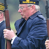 "Record-Eagle/Nathan Payne<br /> Veterans of Foreign Wars Post 2780 honor guard commander Bill Volkening holds a salute while a bugler begins to play ""Taps."""