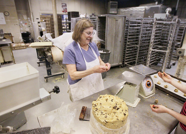 Record-Eagle/Keith King<br /> Claudia DeMarco, owner, weighs cookie dough prior to putting them on sheets Thursday, May 16, 2013 at Grand Traverse Bagel and Bakery in Traverse City.