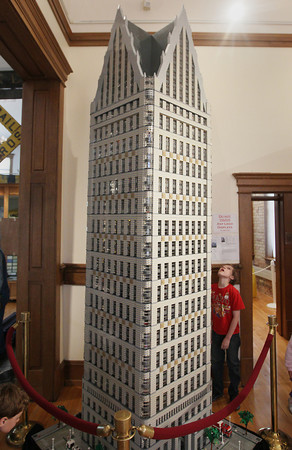"Record-Eagle/Keith King<br /> Jacob Dwyer, 10, of Traverse City, looks at a Lego version of the One Detroit Center building Saturday, May 25, 2013 during the kickoff for ""Lego Carnival: Building Blocks of America""  at the History Center of Traverse City. The Lego event is scheduled to take place through summer. The Lego structure was designed by Scot Thompson, president of the Michigan Lego Users Group."