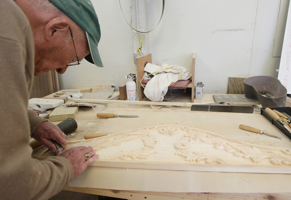 Record-Eagle/Keith King<br /> Howard Byrne, volunteer with the Maritime Heritage Alliance, creates a wood carving Wednesday, May 29, 2013 to be used for a puppet stage at the Great Lakes Children's Museum in Elmwood Township.
