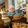 Record-Eagle/Keith King<br /> Laura Quackenbush, of Lake Leelanau, sits near a collection of her woven baskets.