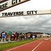 Record-Eagle/Keith King<br /> Spectators walk toward Traverse City Central High School for shelter as the Traverse City Record-Eagle Honor Roll Track Meet is postponed Tuesday due to weather.