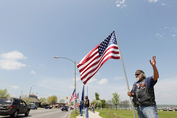 Record-Eagle/Keith King<br /> Lee White, of Rapid City, a member of the U.S. Air Force from 1956 to 1960, waves to passing motorists.