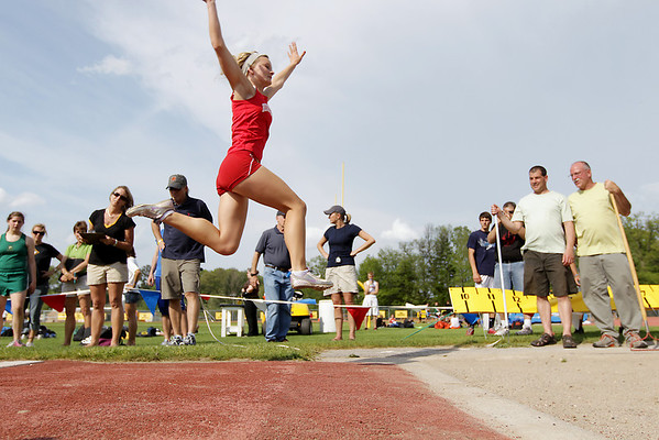 Record-Eagle/Keith King<br /> Benzie Central's Jordan Nye won the long jump Tuesday in one of the few events that finished before rain.