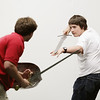 "Record-Eagle/Keith King<br /> A scene is rehearsed by Logan Moore, right, playing Fenris Ulf, and Blake Bandrowski, left, playing Peter, Tuesday, May 31, 2011 during a rehearsal of ""The Lion, the Witch and the Wardrobe"" by the Old Town Playhouse Young Company."