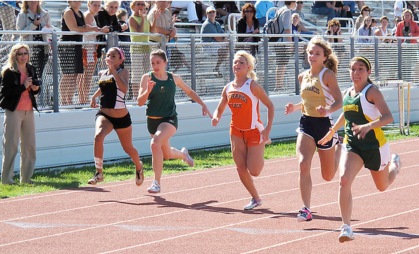 Record-Eagle/Dennis Chase<br /> Forest Area's Marissa Ingersoll (right) pulls away to win the 100 meters Wednesday.
