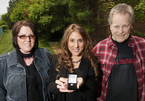 Record-Eagle/Keith King<br /> Leslie Casperson, center, of Old Mission Peninsula, shows her high school class ring. It was returned by Kurt Gallagher and his wife, Lynnette Gallagher, of Grand Haven.