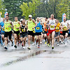 Record-Eagle/Jan-Michael Stump<br /> Led by eventual overall winner Nathan Peters, of Grayling (middle, white hat), competitors take off at the start of the 29th annual Bayshore Marathon in Traverse City on Saturday morning.