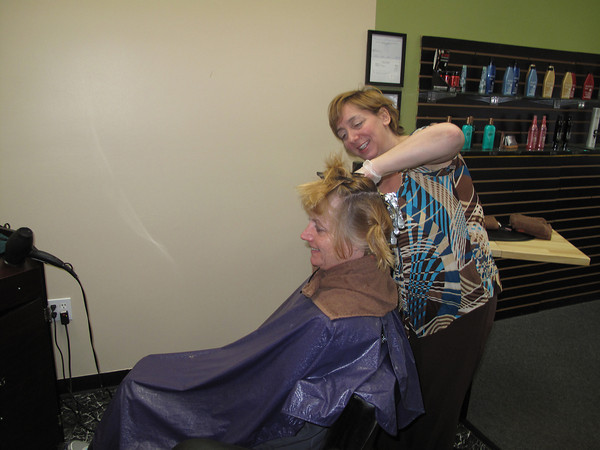Record-Eagle/Glenn Puit<br /> Tracie Berry, right, works on the hair of customer Cherry Robbins at Berry's new salon, Hairport. The business opened April 1 on South Airport Road.