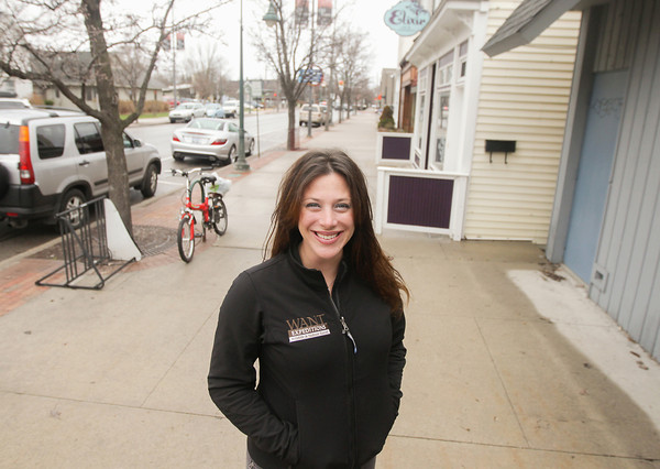Record-Eagle/Keith King<br /> Jessica Pociask, of Traverse City, owner of Wildlife and Nature Travel (WANT) Expeditions, stands along Union Street in Traverse City.