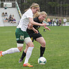 Record-Eagle/Keith King<br /> Traverse City West's Runa Hafnor (20), left, and Traverse City Central's Sierra Fraser (24) battle for control of the ball at Traverse City West Senior High School.