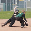 Record-Eagle/Keith King<br /> Traverse City Central's Lexie Mallery (14) slides safely into second base against Traverse City West at Traverse City West Senior High School.