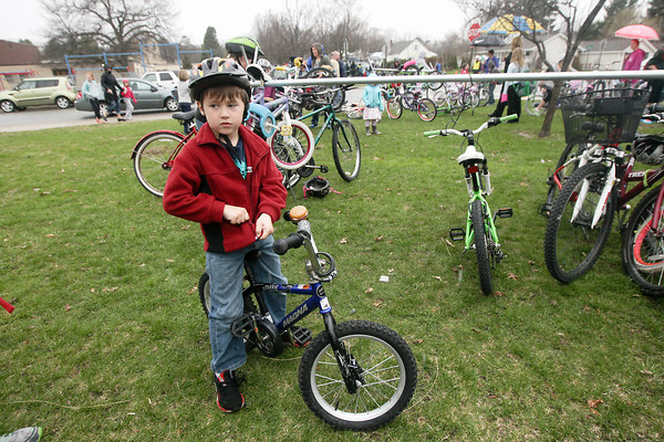 Record-Eagle/Keith King<br /> Jacksen Pownall prepares to ride his bike at the end of the school day at Traverse City Area Public Schools (TCAPS) Montessori at Glenn Loomis as Pownall participates in national Bike to School Day.