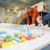Record-Eagle/Keith King<br /> Noel Peyton, of Traverse City, and his son Skyler Peyton, 2, stand at the water table Friday at the Great Lakes Children's Museum.