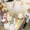 Record-Eagle/Keith King<br /> <br /> Christine Thompson, left, employee, and Linda Pendock, owner, work on a wedding cake at Kingsley Cakes, in Kingsley.