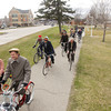 Record-Eagle/Keith King<br /> Magda Schenburn, from left,of Traverse City, and her father, David Schenburn, along with other participants, ride their bicycles at the start of the Tweed Ride TC event in Traverse City.