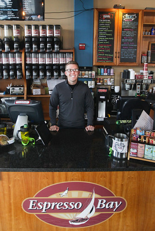 Record-Eagle/Keith King<br /> Dan Guy, owner, stands Thursday at Espresso Bay in downtown Traverse City.