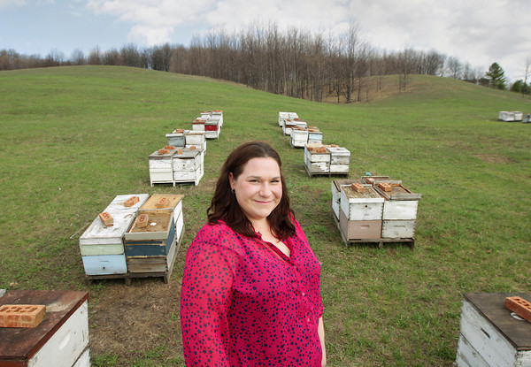 Record-Eagle/Keith King<br /> Mandy Jelinek, of Suttons Bay, stands Thursday, May 2, 2013 near hives of Italian honeybees.