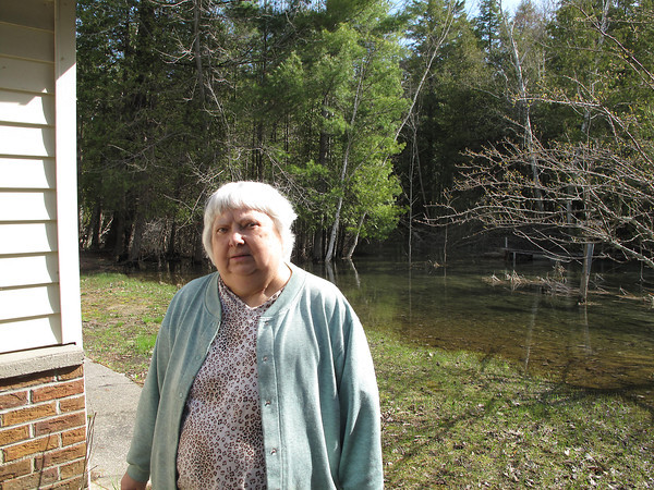 "Betty Wortelboer has had a tough time over the past five weeks.In April, Wortelboer, 73, helplessly watched as floodwaters from the Crystal Lake outlet channel in Benzie County swamped her home along M-115 and forced her to live with relatives until high water subsided this week.""I've gotten a little bit of water before, but this was so fast I couldn't take care of it,"" she said.Wortelboer's house is directly adjacent to the channel used to moderate Crystal Lake water levels. Lake levels are raised or lowered by inserting boards into the outlet, but this year, officials said, it's been particularly difficult to protect Wortelboer's residence while also balancing the needs of lakefront homeowners who've also witnessed high water this spring.""We had a lot of heavy, wet snow, lots of cold temperatures, and the ice built up,"" said Benzie County Drain Commissioner Christy Anderson. ""(Snow melt) happened very fast and it just created a lot of water. The water level is still high on the lake."" The experience frustrates Wortelboer's family. Her nephew, Keith Priest, brought Wortelboer into his home for a couple of weeks, and other family members also helped out. Priest questions whether authorities are doing enough to protect his aunt's well-being, or if favor is being shown to wealthier lakefront owners. ""I'm very upset about it,"" Priest said. ""It's really painful to see it. I'm not in the position to help much and other family members are helping out. I know she doesn't have a lot of money, but we're going to try and make it work.""Terry Money is the county's former drain commissioner. He spent 12 years in the position and said he's never seen a spring snow melt like this year's. He said the drain commissioner's actions -- and the regulation of water coming out of Crystal Lake -- is dictated by a nearly half-century-old court order that stems from long-ago lake level disputes between property owners. ""The road commission was concerned about the culvert on M-115,"" Money said. ""They had to get rid of water in a hurry, be aware of this lady's position and her place, and the road commission was worried about water backing up around the culvert. You'd hate to undermine 115 and blow the culvert out or cause damage.""Wortelboer is glad to be back in her home but she, too, is frustrated. She has to pay extra for flood insurance and faces the hurdle of chasing damage reimbursement from her insurance company.""I'm glad to be back in,"" she said. ""I wanted to get back."""