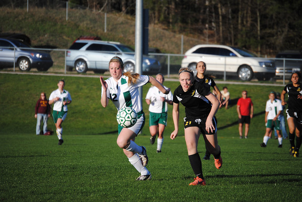 Record-Eagle/James Cook - TC West's Summer Slack and TC Central's Lily Stackable race each other in Soccer.