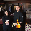 Record-Eagle/Keith King<br /> Renee Myers, left, pastry chef, holds a raspberry and white chocolate tiramisu as Brian Maloney, head chef, holds saganaki Saturday, April 27, 2013 at Uptown in Traverse City.