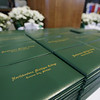 Record-Eagle/Keith King<br /> Northwestern Michigan College diploma binders lie on a table Saturday prior to commencement.