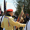 Record-Eagle/Loraine Anderson<br /> Larry Peters, of Mesick, part of the honor guard, stands at attention while Sons of Civil War emcee Tom Jenkins, background, begins the grave dedication service.
