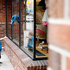 Record-Eagle/Jan-Michael Stump<br /> Wyatt Dorman, 6, helps his mother, Ella's Fashion and Furnishings owner Wendy Dorman, clean the windows outside the Front Street store.