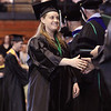 Record-Eagle/Keith King<br /> Audrey Kalchik is congratulated on Saturday during the Northwestern Michigan College commencement ceremony at Traverse City Central High School.