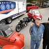 Record-Eagle/Keith King<br /> Jack Koch, left, and his son, Jeff Koch, co-owners of the Garfield Auto Service Center, restore vintage cars and motorcycles. From left, a 1957 Messerschmitt Cabriolet, a 1941 BMW R/71 motorcycle and a 1957 BMW Isetta 300.