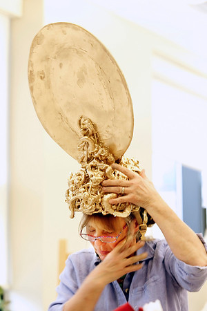 "Record-Eagle/Jan-Michael Stump<br /> Kate Fiebing checks the chin strap for a dancing spoon headpiece for the Interlochen Arts Academy student production of ""Beauty and the Beast,"" which opens Saturday, May 14 at Corson Auditorium."