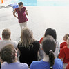 Record-Eagle/Jan-Michael Stump<br /> Olympic gold medalist swimmer Janet Evans speaks with swimmers from TC Breakers, Traverse City Central and Traverse City West Thursday at Easling Pool. Evans is in town to speak on swimming for sport, health and safety Thursday evening at the State Theatre for the New Y Campaign, which is working to raise $4 million for a new Y facility on Silver Lake Road. The new building would feature a public swimming pool. Evans, who swam about 6,000 yards at Easling Pool as part of her daily routine, competed in the 1988, 1992 and 1996 Olympics, winning four gold medals and one silver.